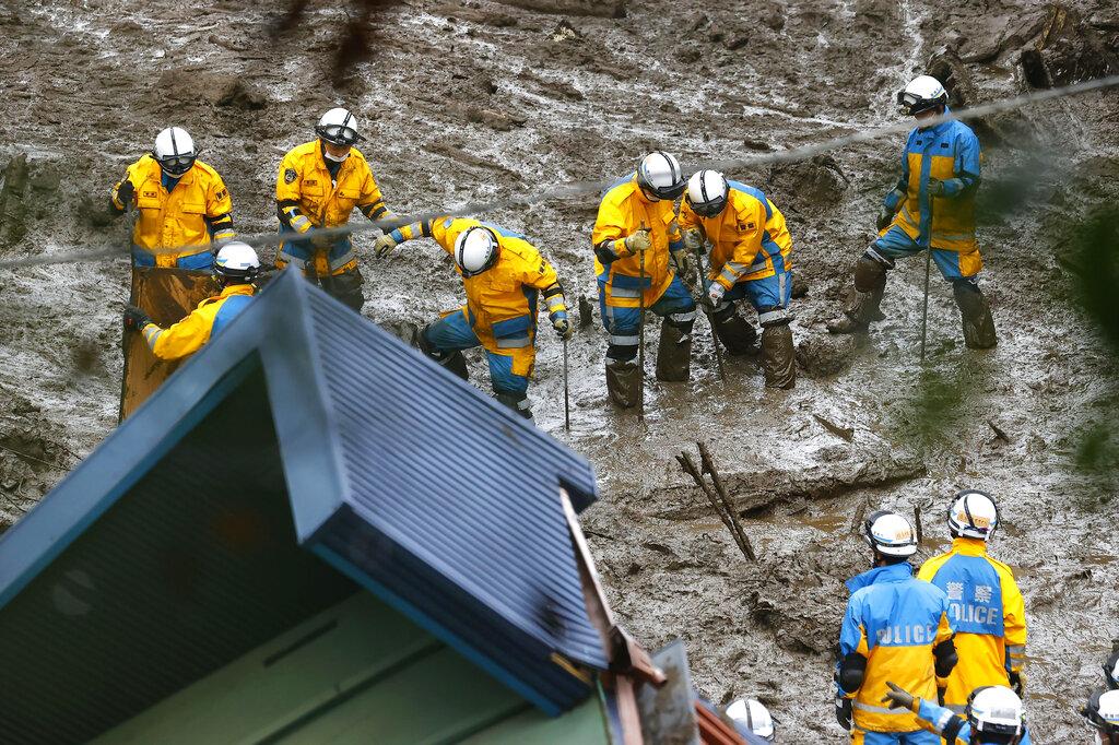 Rescuers during Japanese mudslide