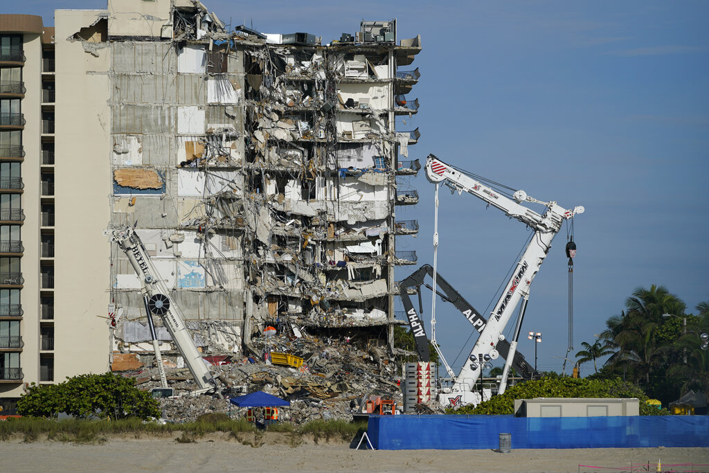 Cranes and workers at Surfside collapse