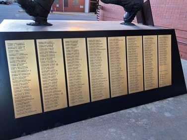 Names of the fallen firefighters of 9-11 on the side of the Siller statue