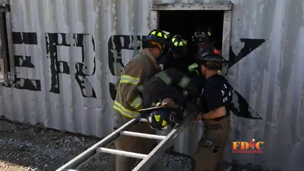 Firefighters train on extracting a person.