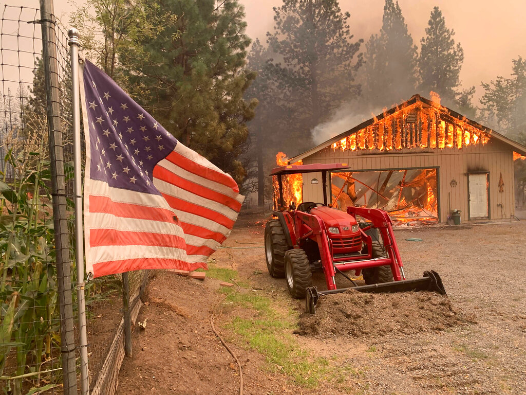 Flag, tractor at California wildfire