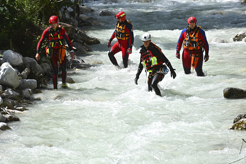 Rescuers stand in rushing waters in Germany