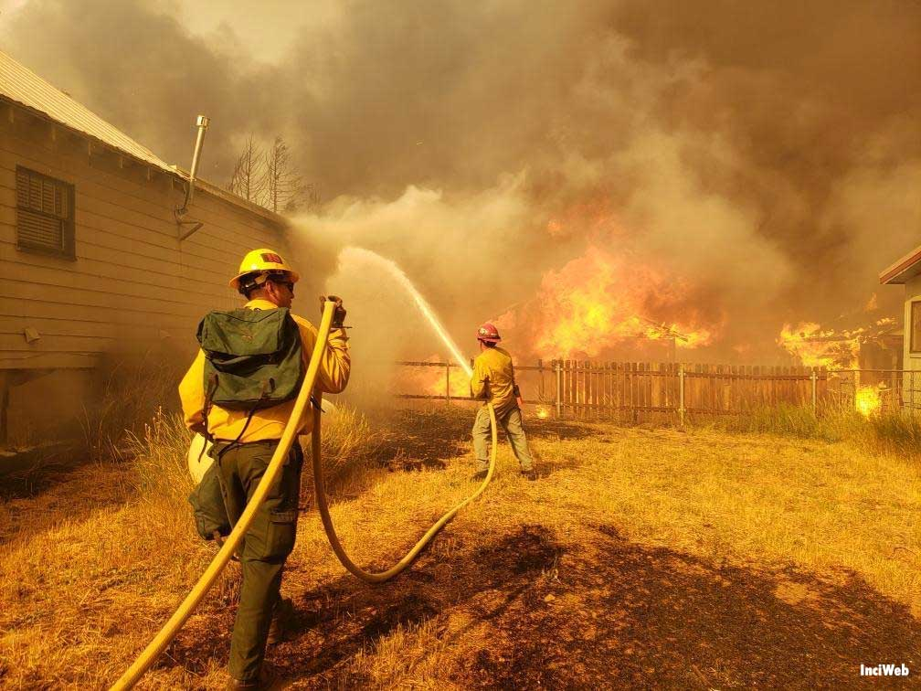 Firefighters working hard to protect homes in Greenville when extreme weather conditions resulted in aggressive fire behavior.