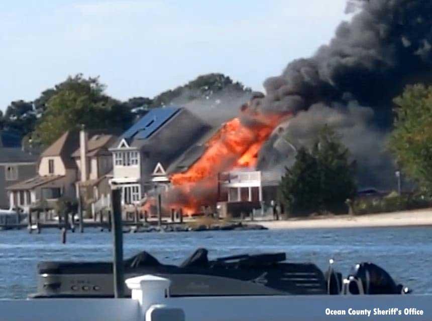 Waterfront fire at Brick homes