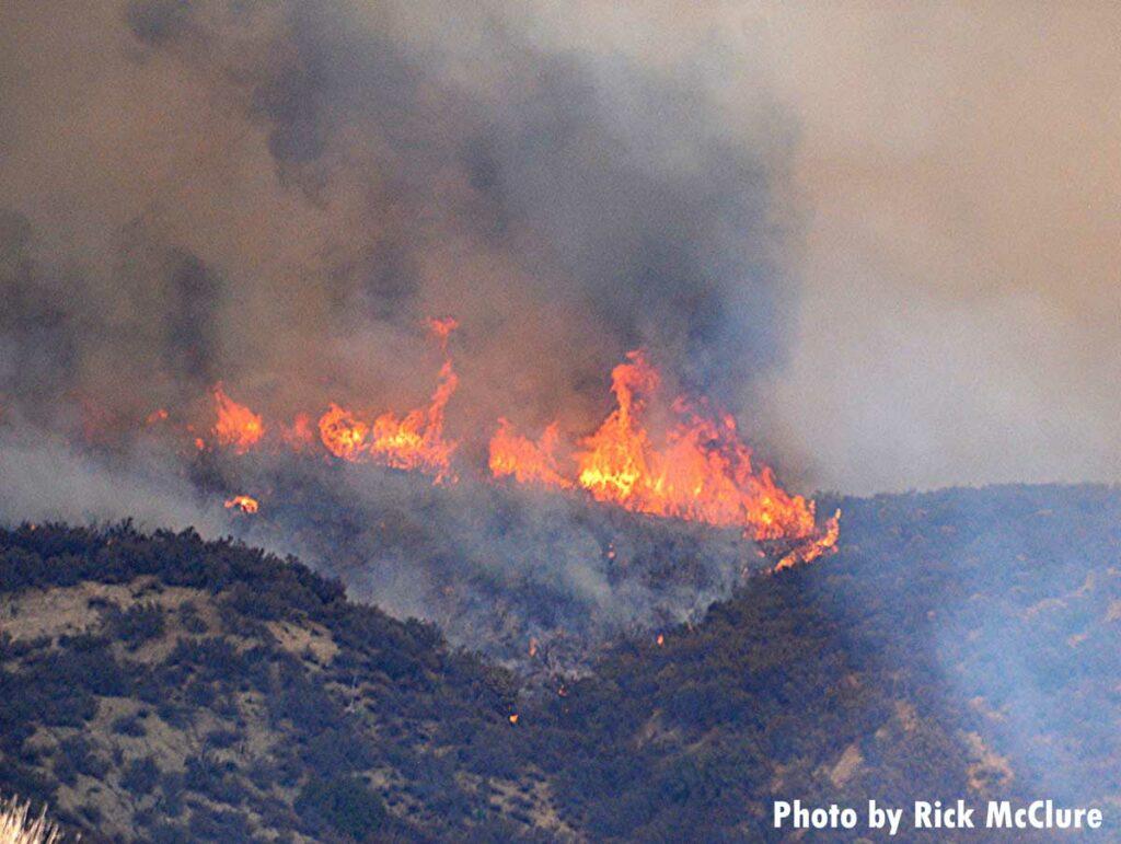 Flames rush up mountain