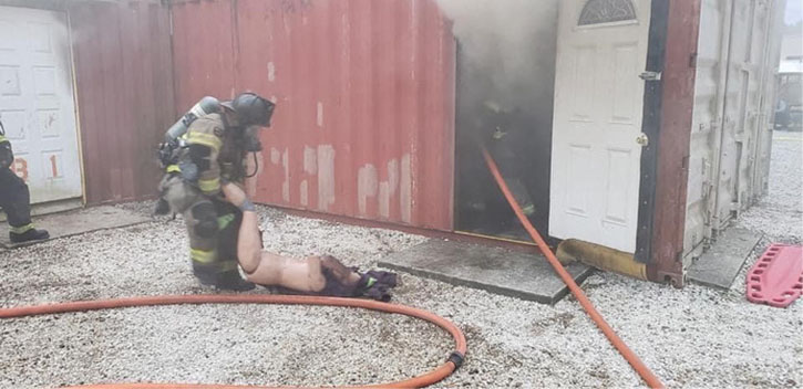 Firefighter drags rescue dummy