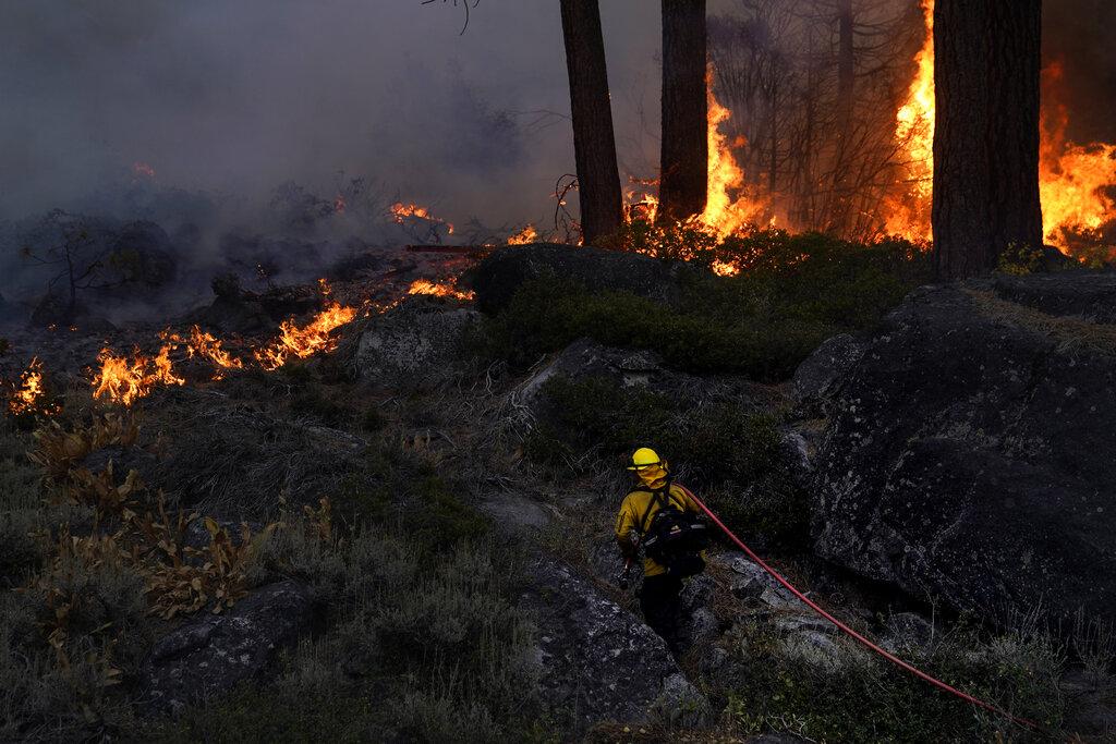 Firefighter battles Caldor fire along ridge