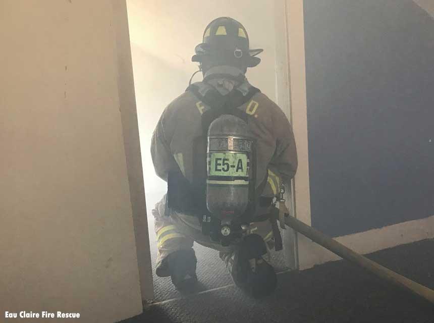 Firefighter in a smoky doorway