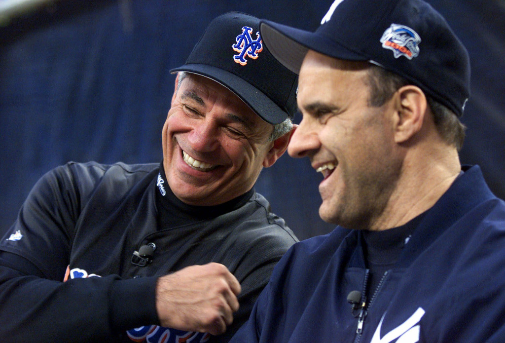 FILE- In this Oct. 21, 2000, file photo, New York Mets manager Bobby Valentine, left, and New York Yankees manager Joe Torre give an interview prior to the start of a World Series baseball game in New York. Sports teams will hold ceremonies Saturday to mark the 20th anniversary of the Sept. 11 terrorist attacks. Valentine, manager of the 2001 Mets, will throw a ceremonial first pitch to Torre, manager of the 2001 Yankees.