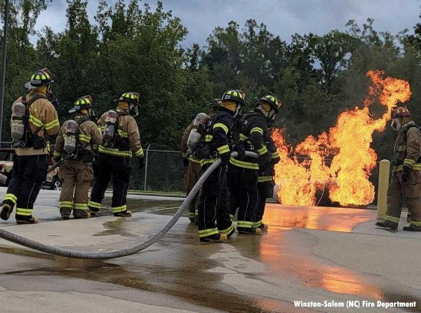 Fire recruits undertake firefighter training on gas prop