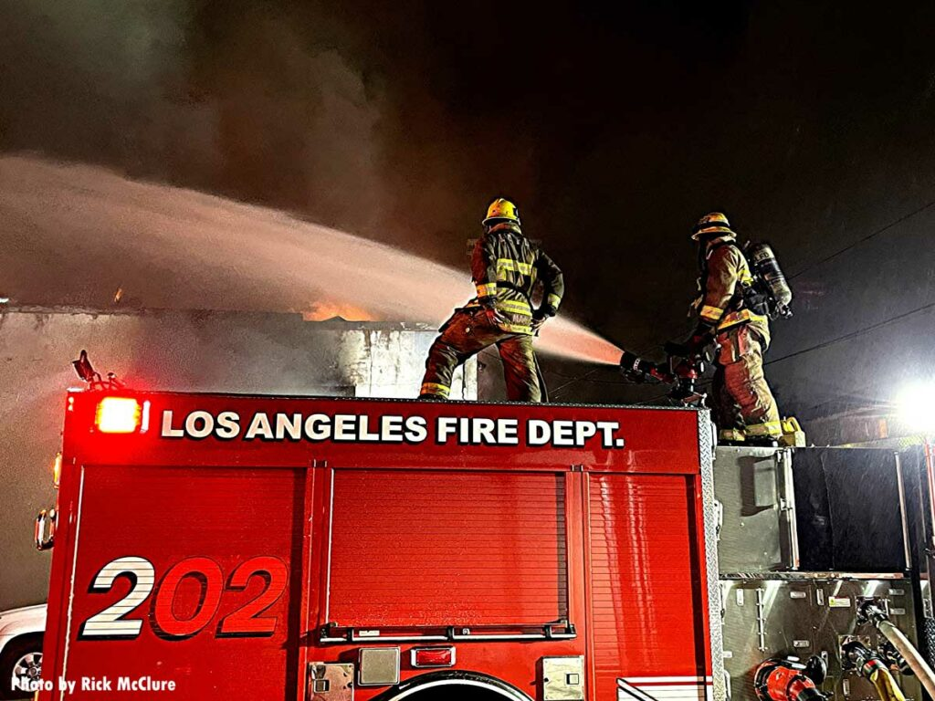 LAFD firefighters with master stream
