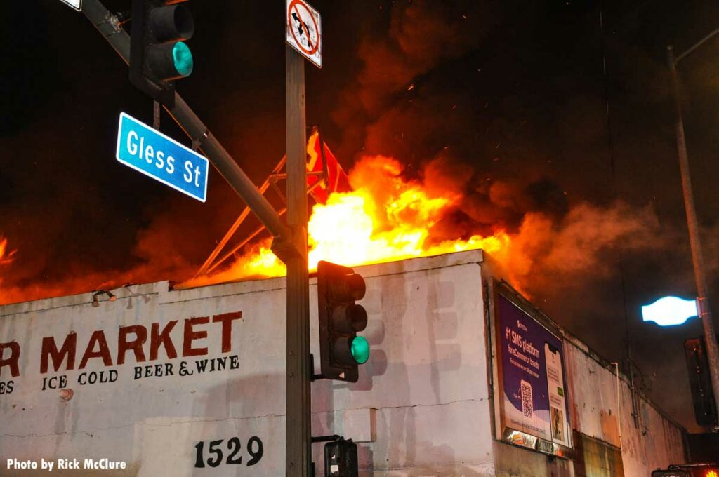 Flames emerge from commercial building's roof