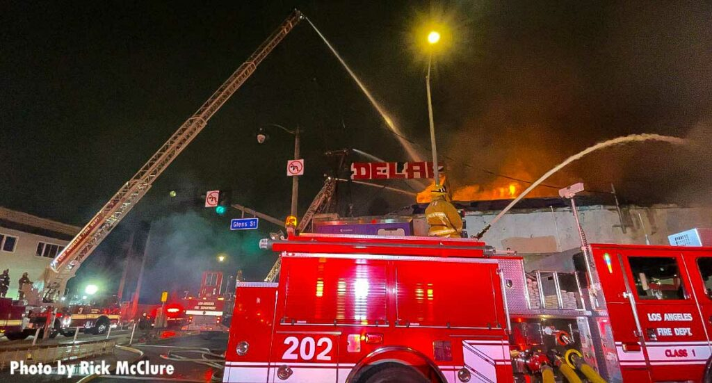 Aerial ladder extended above Los Angeles structure fire